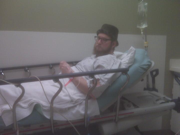J. Michael Grey in bed